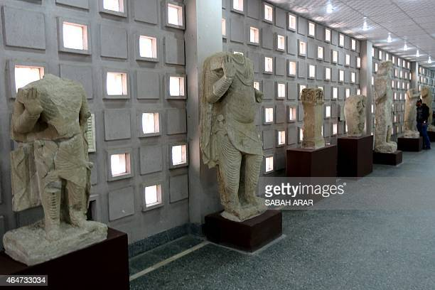 Artefacts coming from the area of Mosul and dating back to the second century BC is displayed during the official reopening of Iraq's national museum...