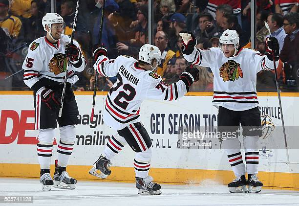 Artem Anisimov and Artemi Panarin of the Chicago Blackhawks celebrate a goal with Patrick Kane against the Nashville Predators during an NHL game at...