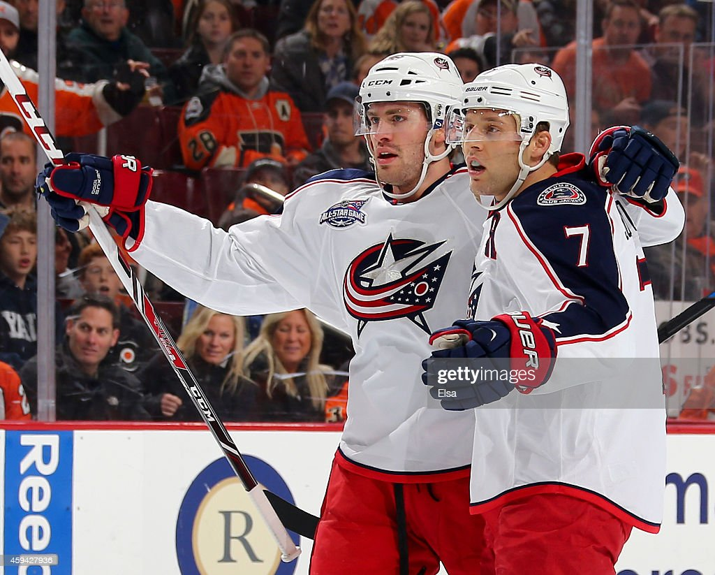 Artem Anisimov #42 and Jack Johnson #7 of the Columbus Blue Jackets celebrate teammate Boone Jenner's goal in the first period against the Philadelphia Flyers on November 22, 2014 at the Wells Fargo Center in Philadelphia, Pennsylvania.