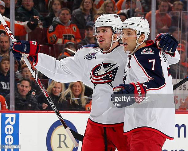 Artem Anisimov and Jack Johnson of the Columbus Blue Jackets celebrate teammate Boone Jenner's goal in the first period against the Philadelphia...