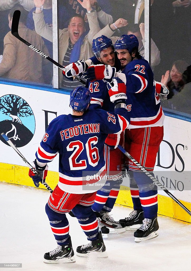 Artem Anisimov celebrates his third period goal with Brian Boyle and Ruslan Fedotenko of the New York Rangers in Game One of the Eastern Conference...