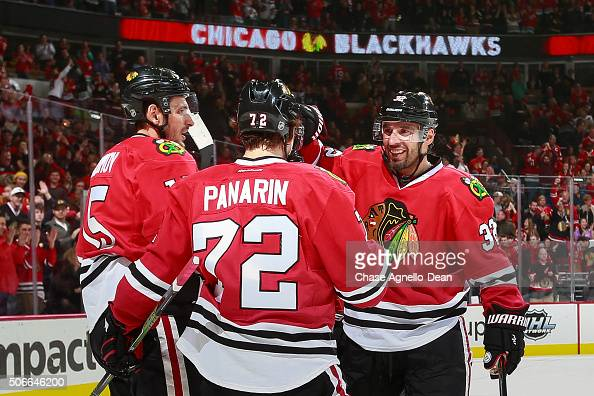 Artem Anisimov Michal Rozsival and Artemi Panarin of the Chicago Blackhawks celebrate after Panarin scored against the St Louis Blues in the second...