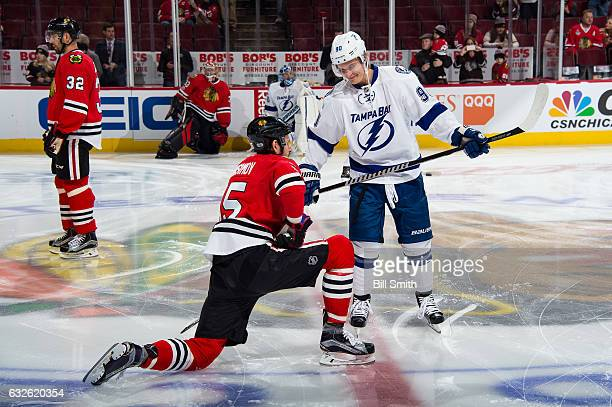 Artem Anisimov of the Chicago Blackhawks and Vladislav Namestnikov of the Tampa Bay Lightning talk during warmups prior to the game at the United...