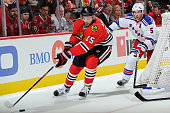 Artem Anisimov of the Chicago Blackhawks approaches the puck as Dan Girardi of the New York Rangers follows in the second period during the season...