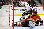 Artem Anisimov of the Chicago Blackhawks battles for a loose puck with Hampus Lindholm of the Anaheim Ducks and John Gibson of the Anaheim Ducks...