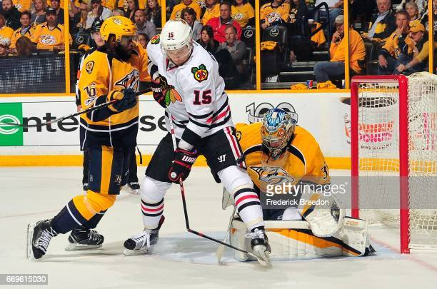 Artem Anisimov of the Chicago Blackhawks breaks his stick while being tied up by PKSubban of the Nashville Predators in front of Predator goalie...