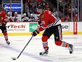 Artem Anisimov of the Chicago Blackhawks breaks up the ice against the New Jersey Devils at the United Center on November 12 2015 in Chicago Illinois...