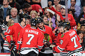 Artem Anisimov of the Chicago Blackhawks celebrates with teammates including Viktor Svedberg and Artemi Panarin after scoring in the first period of...