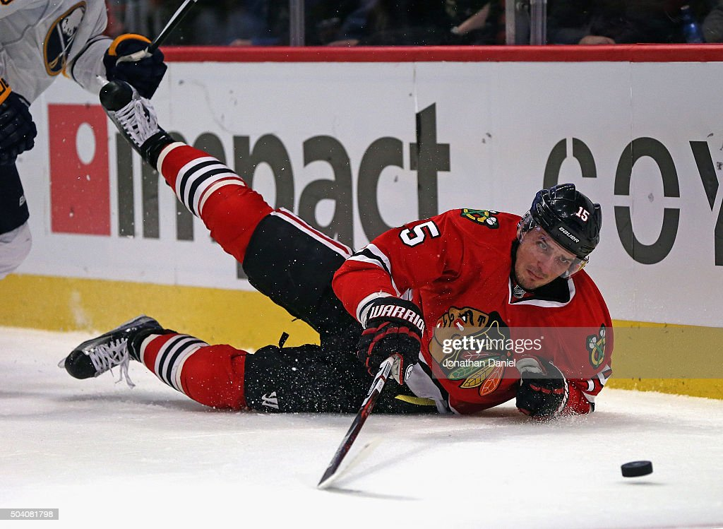 <a gi-track='captionPersonalityLinkClicked' href=/galleries/search?phrase=Artem+Anisimov&family=editorial&specificpeople=543215 ng-click='$event.stopPropagation()'>Artem Anisimov</a> #15 of the Chicago Blackhawks hits the ice while chasing the puck against the Buffalo Sabres at the United Center on January 8, 2016 in Chicago, Illinois.