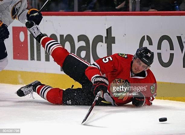 Artem Anisimov of the Chicago Blackhawks hits the ice while chasing the puck against the Buffalo Sabres at the United Center on January 8 2016 in...