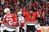 Artem Anisimov of the Chicago Blackhawks reacts after scoring against the Ottawa Senators in the third period of the NHL game at the United Center on...