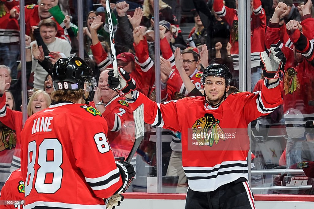<a gi-track='captionPersonalityLinkClicked' href=/galleries/search?phrase=Artem+Anisimov&family=editorial&specificpeople=543215 ng-click='$event.stopPropagation()'>Artem Anisimov</a> #15 of the Chicago Blackhawks reacts after scoring an empty net goal in the third period of the NHL game against the Edmonton Oilers at the United Center on November 8, 2015 in Chicago, Illinois.