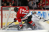 Artem Anisimov of the Chicago Blackhawks scores a shorthanded goal against Jonathan Quick of the Los Angeles Kings in the third period at the United...