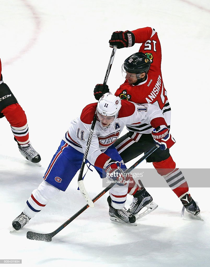 Artem Anisimov of the Chicago Blackhawks tries to knock the puck away from Brendan Gallagher of the Montreal Canadiens at the United Center on...