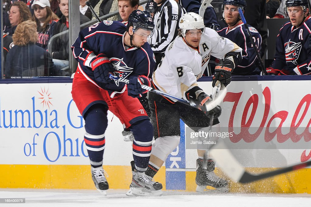 Artem Anisimov #42 of the Columbus Blue Jackets and Teemu Selanne #8 of the Anaheim Ducks battle for control of the puck on March 31, 2013 at Nationwide Arena in Columbus, Ohio.