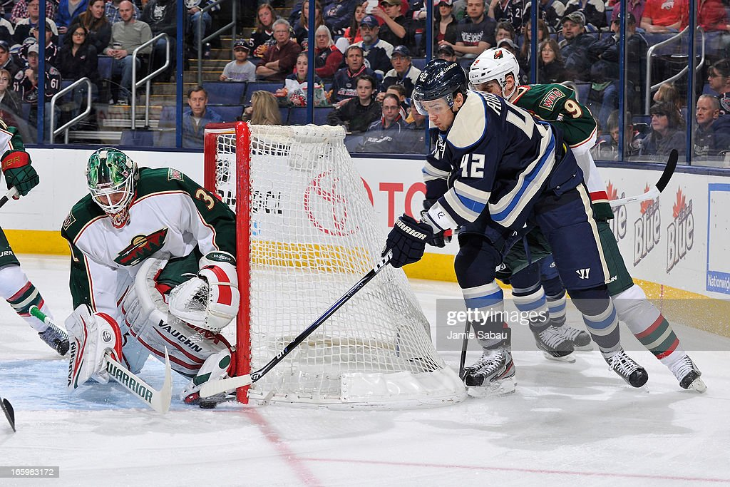Artem Anisimov #42 of the Columbus Blue Jackets attempts a wrap-around shot on Goaltender Niklas Backstrom #32 of the Minnesota Wild during the first period on April 7, 2013 at Nationwide Arena in Columbus, Ohio.