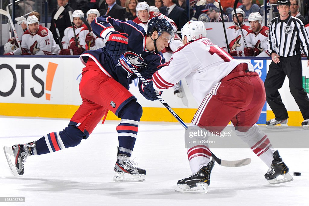 Artem Anisimov #42 of the Columbus Blue Jackets attempts to skate past the defense of Rostislav Klesla #16 of the Phoenix Coyotes during the first period on March 16, 2013 at Nationwide Arena in Columbus, Ohio.