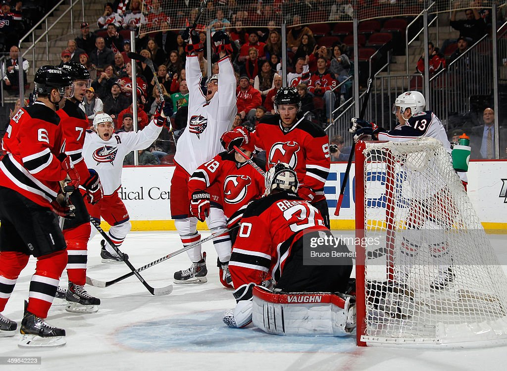 Artem Anisimov of the Columbus Blue Jackets celebrates his goal at 742 of he first period against Martin Brodeur of the New Jersey Devils at the...