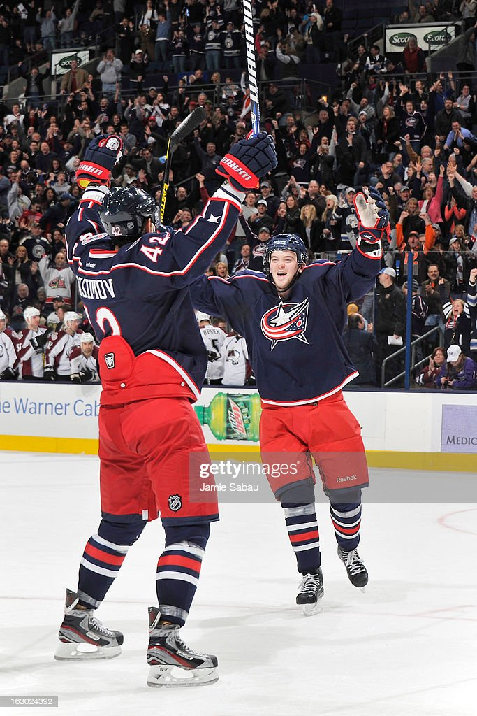 <a gi-track='captionPersonalityLinkClicked' href=/galleries/search?phrase=Artem+Anisimov&family=editorial&specificpeople=543215 ng-click='$event.stopPropagation()'>Artem Anisimov</a> #42 of the Columbus Blue Jackets celebrates his game-winning power play goal in overtime against the Colorado Avalanche with teammate <a gi-track='captionPersonalityLinkClicked' href=/galleries/search?phrase=Tim+Erixon+-+Ice+Hockey+Player&family=editorial&specificpeople=8546945 ng-click='$event.stopPropagation()'>Tim Erixon</a> #20 of the Columbus Blue Jackets on March 3, 2013 at Nationwide Arena in Columbus, Ohio. Columbus defeated Colorado 2-1 in overtime.