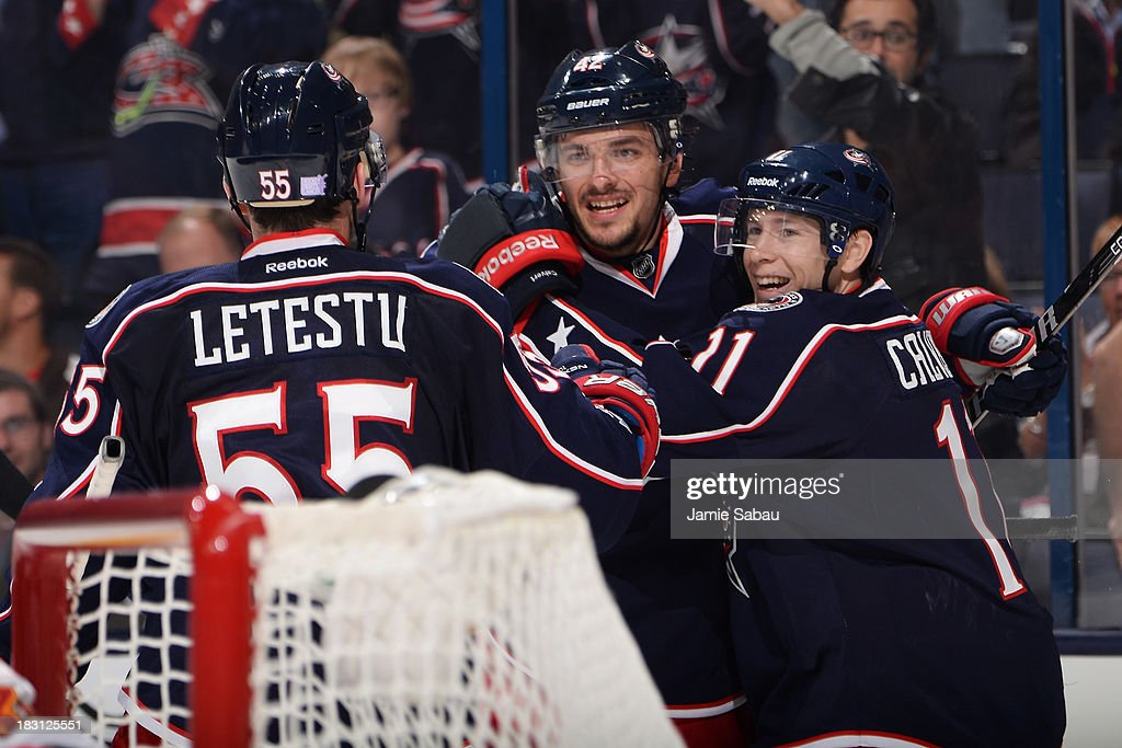 Artem Anisimov #42 of the Columbus Blue Jackets celebrates his third period goal with Mark Letestu #55 and Matt Calvert #11 during the game against the Calgary Flames on October 4, 2013 at Nationwide Arena in Columbus, Ohio. Calgary defeated Columbus 4-3.