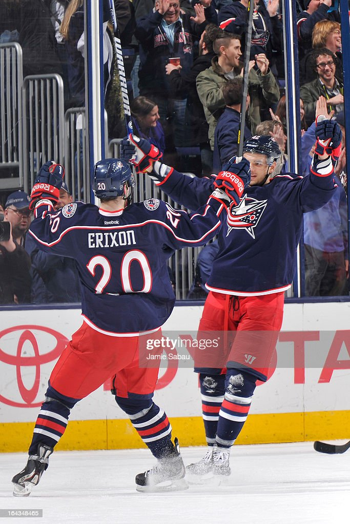 Artem Anisimov #42 of the Columbus Blue Jackets celebrates with teammate Tim Erixon #20 of the Columbus Blue Jackets after scoring an unassisted goal against the Calgary Flames in the second period on March 22, 2013 at Nationwide Arena in Columbus, Ohio.