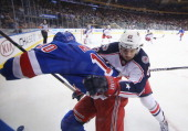 Artem Anisimov of the Columbus Blue Jackets checks JT Miller of the New York Rangers during their game at Madison Square Garden on January 6 2014 in...