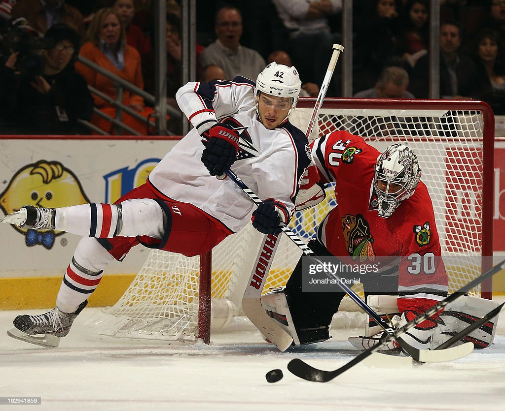 Artem Anisimov of the Columbus Blue Jackets looses his balance after Ray Emery of the Chicago Blackhawks rejected his shot at the United Center on...