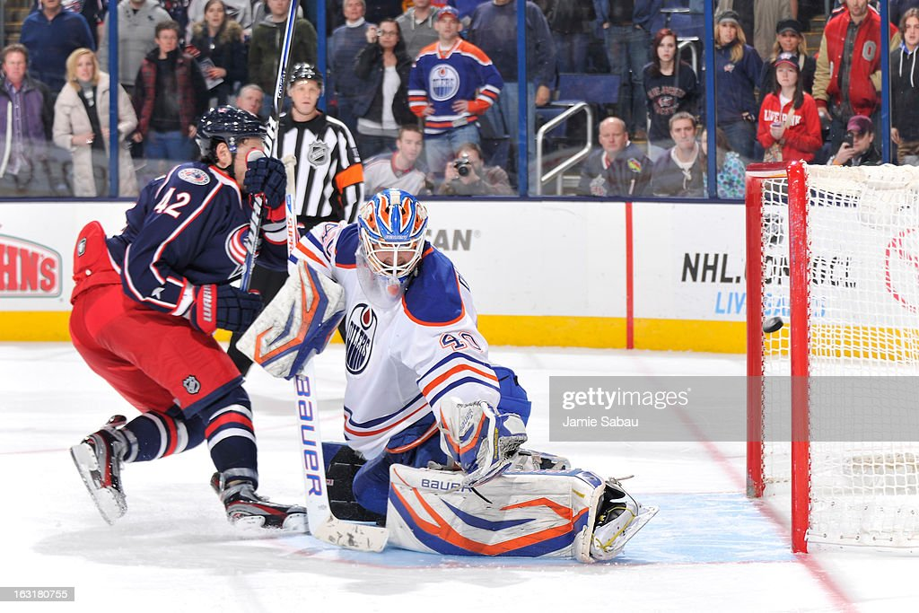 Artem Anisimov of the Columbus Blue Jackets scores on goaltender Devan Dubnyk of the Edmonton Oilers in the shootout on March 5 2013 at Nationwide...