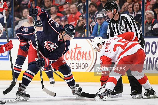 Artem Anisimov of the Columbus Blue Jackets takes a face off against Cory Emmerton of the Detroit Red Wings on March 11 2014 at Nationwide Arena in...
