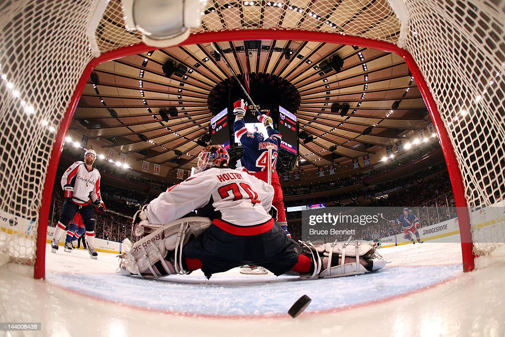 <a gi-track='captionPersonalityLinkClicked' href=/galleries/search?phrase=Artem+Anisimov&family=editorial&specificpeople=543215 ng-click='$event.stopPropagation()'>Artem Anisimov</a> #42 of the New York Rangers celebrates as teammate Marc Staal #18 (Not Pictured) scores the winning goal in overtime against <a gi-track='captionPersonalityLinkClicked' href=/galleries/search?phrase=Braden+Holtby&family=editorial&specificpeople=5370964 ng-click='$event.stopPropagation()'>Braden Holtby</a> #70 of the Washington Capitals in Game Five of the Eastern Conference Semifinals during the 2012 NHL Stanley Cup Playoffs at Madison Square Garden on May 7, 2012 in New York City. The New York Rangers defeated the Washington Capitals in overtime 2-3.