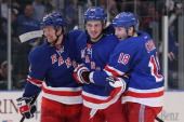 Artem Anisimov of the New York Rangers celebrates his second period goal with Marc Staal and Anton Stralman in the second period of Game One of the...