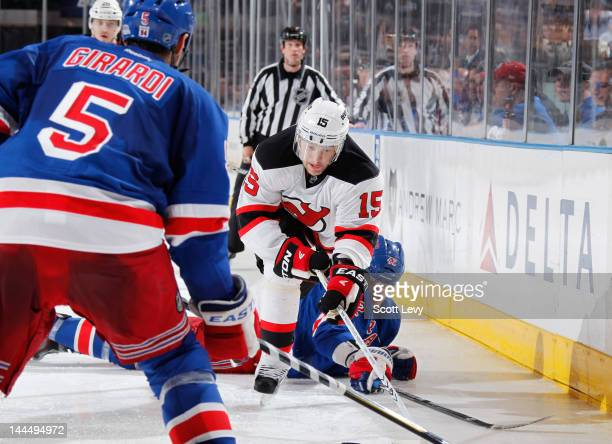 Artem Anisimov of the New York Rangers collides with Petr Sykora of the New Jersey Devils in Game One of the Eastern Conference Final during the 2012...