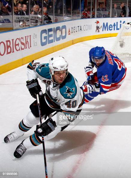 Artem Anisimov of the New York Rangers skates against Kent Huskins of the San Jose Sharks during the first period on October 19 2009 at Madison...