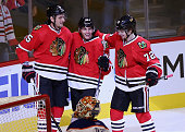 Artem Anisimov Patrick Kane and Artemi Panarin of the Chicago Blackhawks celebrate a goal against the Edmonton Oilers at the United Center on...
