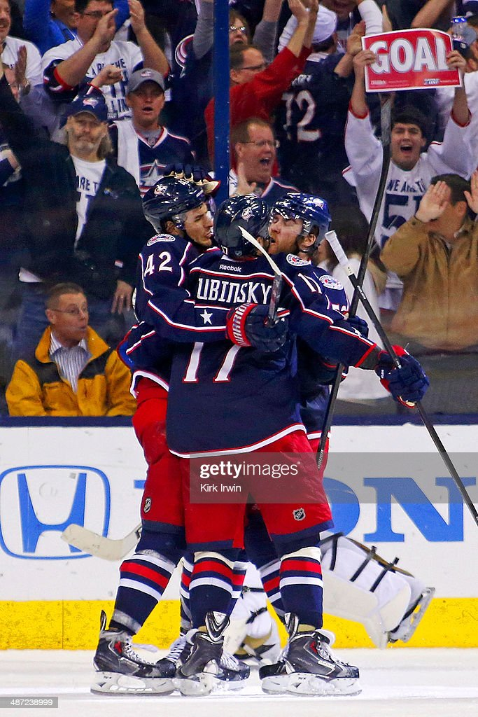 Artem Ansimov #42 is congratulated by <a gi-track='captionPersonalityLinkClicked' href=/galleries/search?phrase=Brandon+Dubinsky&family=editorial&specificpeople=2271907 ng-click='$event.stopPropagation()'>Brandon Dubinsky</a> #17 and <a gi-track='captionPersonalityLinkClicked' href=/galleries/search?phrase=David+Savard&family=editorial&specificpeople=4630692 ng-click='$event.stopPropagation()'>David Savard</a> #58, all of the Columbus Blue Jackets after scoring a goal against the Pittsburgh Penguins during the third period of Game Six of the First Round of the 2014 NHL Stanley Cup Playoffs at Nationwide Arena on April 28, 2014 in Columbus, Ohio. Pittsburgh defeated Columbus 4-3 to win the series four games to two.