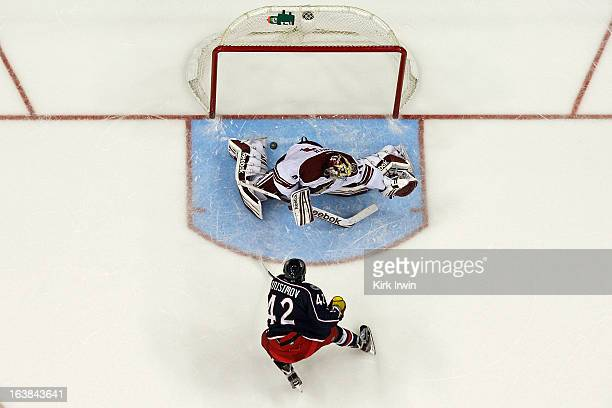 Artem Ansimov of the Columbus Blue Jackets beats Mike Smith of the Phoenix Coyotes for a goal during the shootout on March 16 2013 at Nationwide...