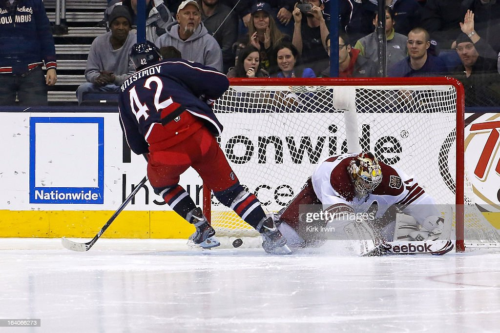 Artem Ansimov #42 of the Columbus Blue Jackets beats Mike Smith #41 of the Phoenix Coyotes for a goal during the shootout on March 16, 2013 at Nationwide Arena in Columbus, Ohio. Columbus defeated Phoenix 1-0 in a shootout.