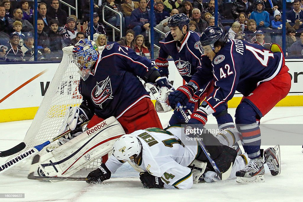 Artem Ansimov #42 of the Columbus Blue Jackets checks <a gi-track='captionPersonalityLinkClicked' href=/galleries/search?phrase=Jamie+Benn&family=editorial&specificpeople=4595070 ng-click='$event.stopPropagation()'>Jamie Benn</a> #14 of the Dallas Stars as Sergei Bobrovsky #72 of the Columbus Blue Jackets looks for the puck after stopping a shot during the third period on January 28, 2013 at Nationwide Arena in Columbus, Ohio. Columbus defeated Dallas 2-1.