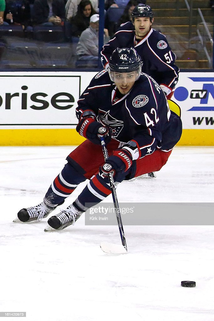 Artem Ansimov #42 of the Columbus Blue Jackets controls the puck during the game against the Calgary Flames on February 7, 2013 at Nationwide Arena in Columbus, Ohio.