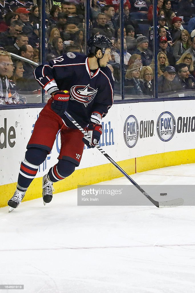 Artem Ansimov #42 of the Columbus Blue Jackets controls the puck during the game against the Calgary Flames on March 22, 2013 at Nationwide Arena in Columbus, Ohio.