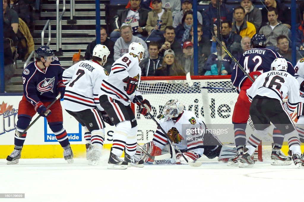 Artem Ansimov #42 of the Columbus Blue Jackets flips the puck past Corey Crawford #50 of the Chicago Blackhawks to score a goal during the third period on January 26, 2013 at Nationwide Arena in Columbus, Ohio. Chicago defeated Columbus 3-2.