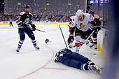 Artem Ansimov of the Columbus Blue Jackets lays on the ice after being hit by Eric Gryba of the Ottawa Senators during the second period on October...