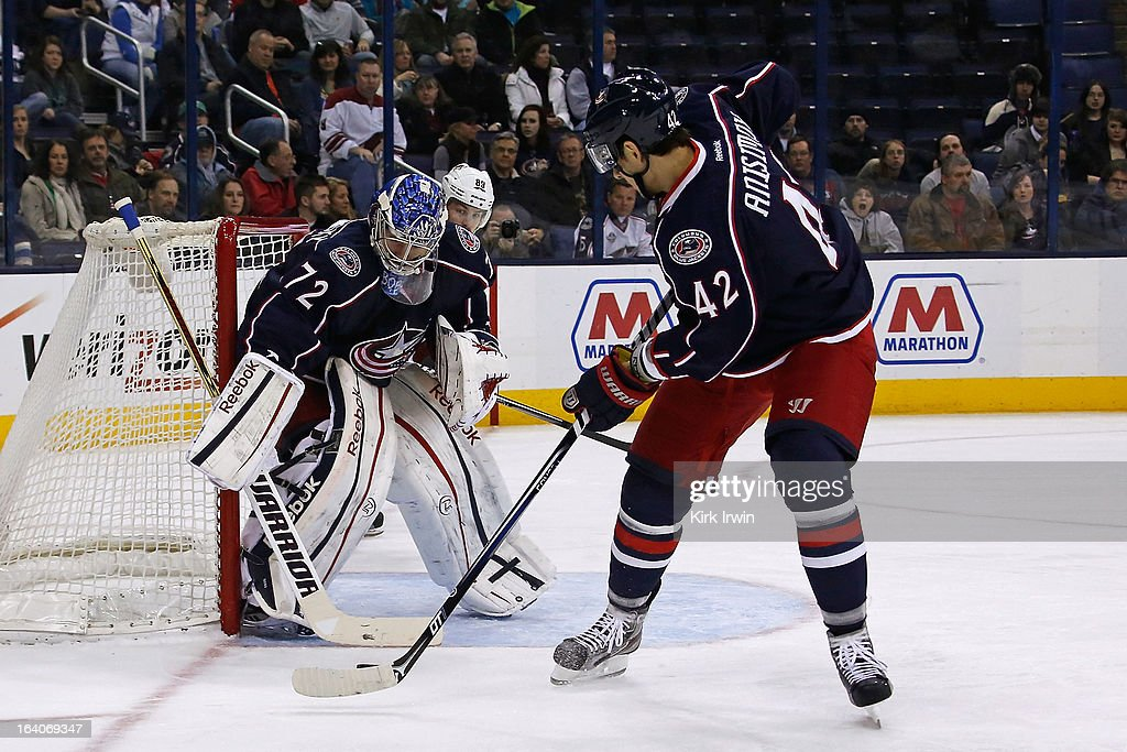 Artem Ansimov #42 of the Columbus Blue Jackets passes the puck back to Sergei Bobrovsky #72 of the Columbus Blue Jackets during the game against the Phoenix Coyotes on March 16, 2013 at Nationwide Arena in Columbus, Ohio.