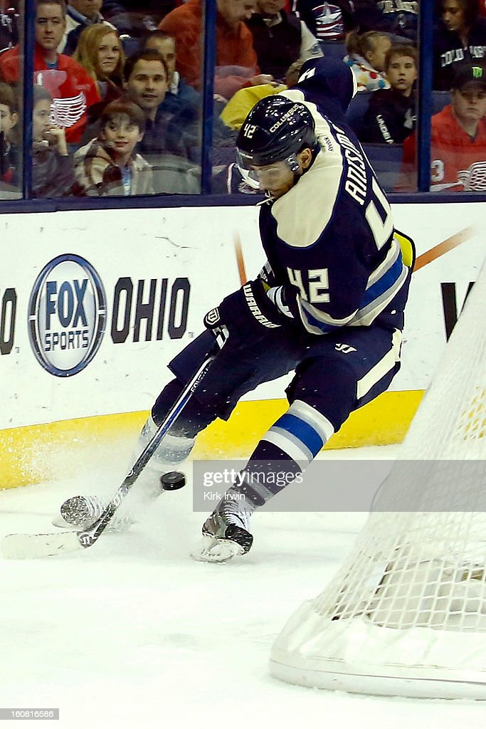 Artem Ansimov #42 of the Columbus Blue Jackets skates with the puck during the game against the Detroit Red Wings on February 2, 2013 at Nationwide Arena in Columbus, Ohio.