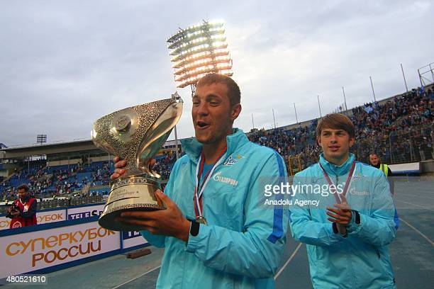 Artem Dzuba and Alexey Evseev of FC Zenit St Petersburg celebrates with the trophy after winning the Super Cup of Russia following the match against...