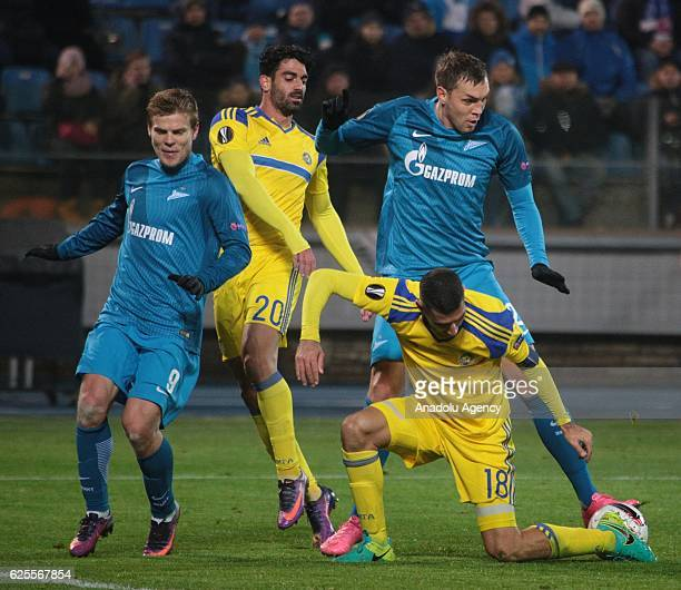 Artem Dzyuba and Alexander Kokorin of Zenit in action against Omri Ben Harush and Eytan Tibi of Maccabi TelAviv during the UEFA Europa League Group D...