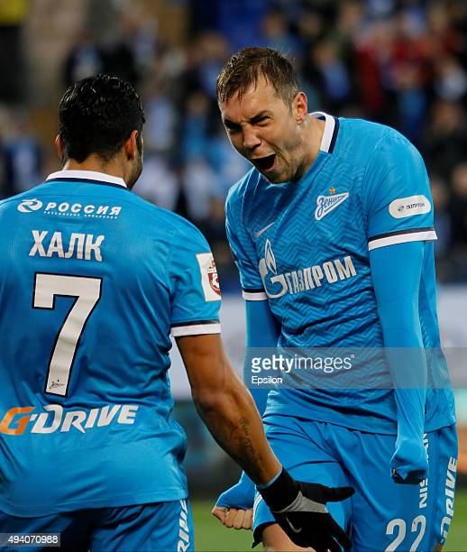 Artem Dzyuba celebrates his goal with Hulk of FC Zenit St Petersburg during the Russian Football League match between FC Zenit St Petersburg and FC...