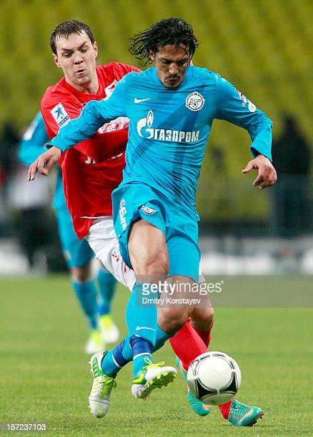 Artem Dzyuba of FC Spartak Moscow competes with Bruno Alves of FC Zenit St Petersburg during the Russian Premier League match between FC Spartak...