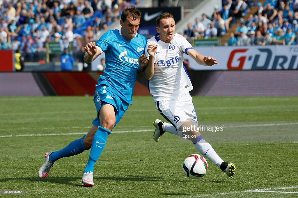 Artem Dzyuba (L) of FC Zenit St. Petersburg and Aleksei Kozlov of FC Dinamo Moscow vie for the ball during the Russian Football League match between FC Zenit St. Petersburg and FC Dinamo Moscow at the Petrovsky stadium on July 19, 2015 in St. Petersburg, Russia.