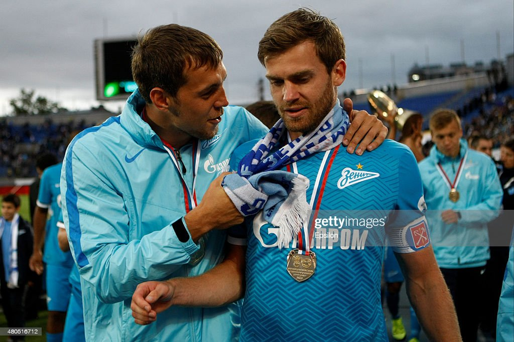 <a gi-track='captionPersonalityLinkClicked' href=/galleries/search?phrase=Artem+Dzyuba&family=editorial&specificpeople=4408829 ng-click='$event.stopPropagation()'>Artem Dzyuba</a> (L) of FC Zenit St. Petersburg and <a gi-track='captionPersonalityLinkClicked' href=/galleries/search?phrase=Nicolas+Lombaerts&family=editorial&specificpeople=4332055 ng-click='$event.stopPropagation()'>Nicolas Lombaerts</a> of FC Zenit St. Petersburg celebrate winning the Super Cup of Russia 2015 match between FC Zenit St. Petersburg and FC Lokomotiv Moscow at the Petrovsky stadium on July 12, 2015 in St. Petersburg, Russia.